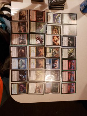 Photo Lot of magic the gathering cards mythics, rares, uncommons,commons, and holos