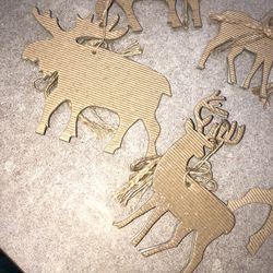 """3 7"""" gold/silver glitter deer, 4 4"""" thin wood w/bells, and 4 4"""" moose Christmas ornaments Thumbnail"""